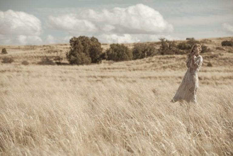 Fashion photographer Dylan H Brown captures a woman in a dress in a field of tall grass