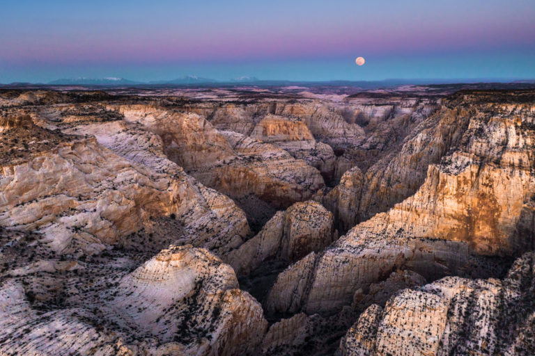 A full moon rises over the Escalante Canyon.
