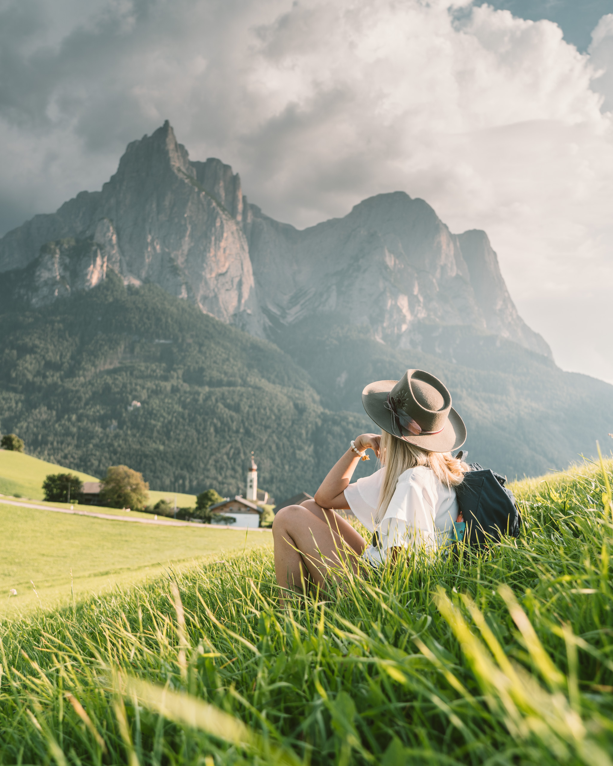 Woman looks at dramatic mountain in the Dolomites in Northern Italy