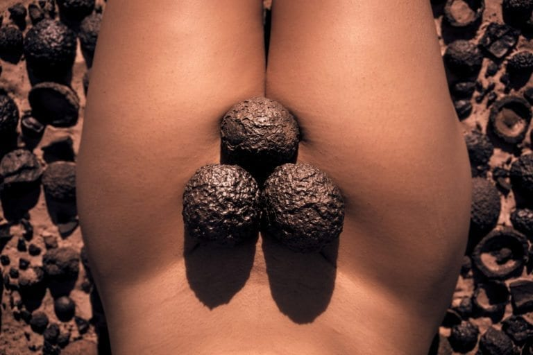 Moqui balls on a naked woman